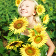 Young girl in the field of sunflowers — Stock Photo