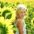 Dreamy young girl in the field of sunflowers — Stock Photo