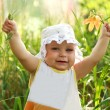 Happy smiling baby girl showing hands up — Stock Photo