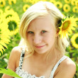 Beautyful portrait of summer young girl in field of sunflowers — Stock Photo #11977156