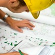 Builder checking plans — Stock Photo #11770773