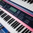 Stock Photo: Electronic music synthesizer keyboards on rack