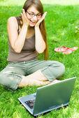 Happy girl outside with laptop — Foto de Stock