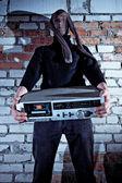 Burglar stealing electronics — Stock Photo