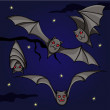 Bats on the night sky - Stock Vector