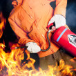 Fireman fighting a raging fire with big flames — Stok fotoğraf