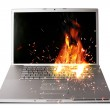 Laptop computer on fire, represents computer damage, loss of data — Stock Photo