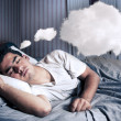 Man comfortably dreaming in his bed with a cloud — Stock Photo #11325129
