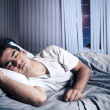 Stock Photo: Mcomfortably sleeping in his bed