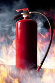 Fire extinguisher and flames — Stock Photo
