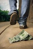 Unlucky man drops money — Stock Photo