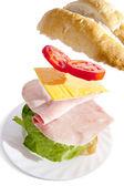 Irresistible ham sandwich on white background — Stock Photo
