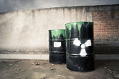 Toxic drum barrels spilled their hazardous content contaminating the earth — Stock Photo