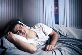 Man comfortably sleeping in his bed — Stock Photo