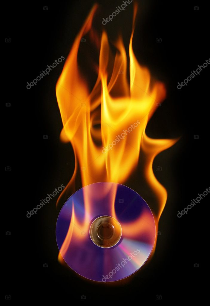 Conceptual photo representing burning a DVD (or CD, Bluray, etc) isolated on black — Stock Photo #11322903