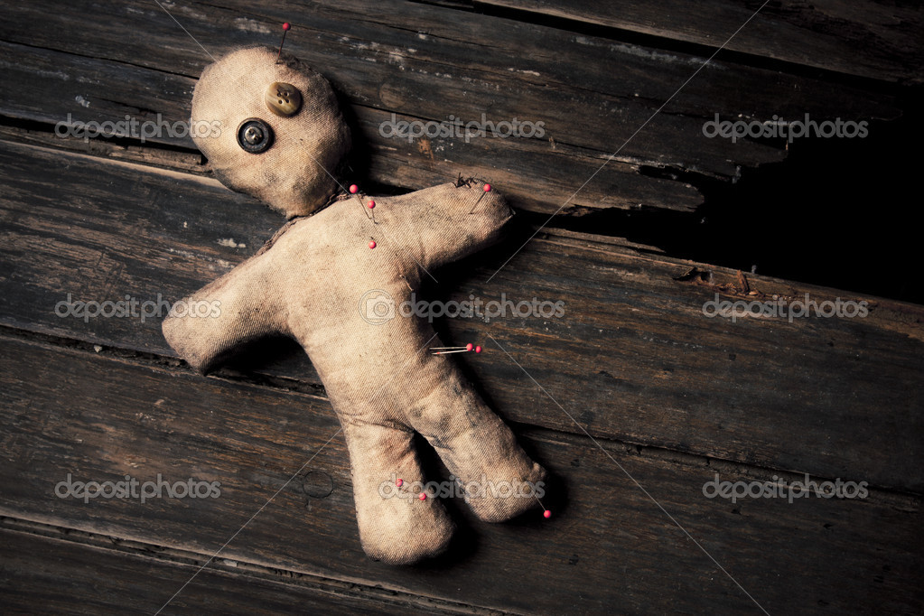 Photo of creepy voodoo doll on wooden floor  Stock Photo #11324394