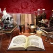 Stock Photo: Table full of witchcraft related objects and cobwebs