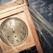 Vintage wall clock full of cobwebs - Stock Photo