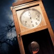 Dark antique clock at night - Stock Photo