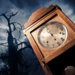 Dark antique clock at night — Stock Photo