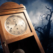 Stock Photo: Dark antique clock at night