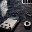 Dark prison cell at night - Foto Stock