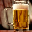 Refreshing beer mug on vintage background — Stock Photo