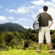A tourist a top beautiful Mountain contemplating the view — Stock Photo