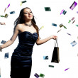 A beautiful portrait of a happy attractive woman with credit cards raining over her — ストック写真