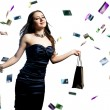 A beautiful portrait of a happy attractive woman with credit cards raining over her — Stock fotografie