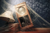 Vintage wall clock full of cobwebs — Stock Photo