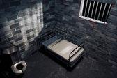 Dark prison cell at night — Stok fotoğraf
