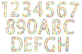 Abc and numbers in upper caps made of candy isolated on white. — Stock Photo