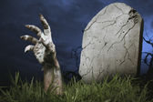 Zombie hand coming out of the ground — Stock Photo