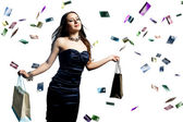 A beautiful portrait of a happy attractive woman with credit cards raining over her — Stock Photo