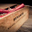Dangerous dynamite sticks on wooden a box — Stock Photo