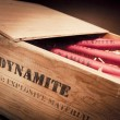Dangerous dynamite sticks on wooden box — Stock Photo #11604980