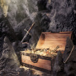 Stock Photo: Open treasure chest with bright gold in cave