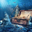 Open treasure chest with bright gold underwater — Стоковая фотография