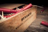 Dangerous dynamite sticks on wooden a box — Stock Photo
