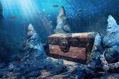 Closed treasure chest underwater — Stock Photo