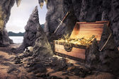 Open treasure chest with bright gold in a cave — Foto Stock