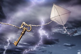 Kite with a key flying in a storm — Fotografia Stock