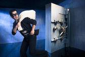 Thief running away with money — Stock Photo