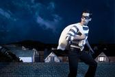 Thief walking on the roof of a house at night — Stock Photo