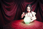 Dark vintage photo of a gypsy with her crystal ball — Stock Photo