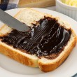 Stock Photo: Spreading Vegemite