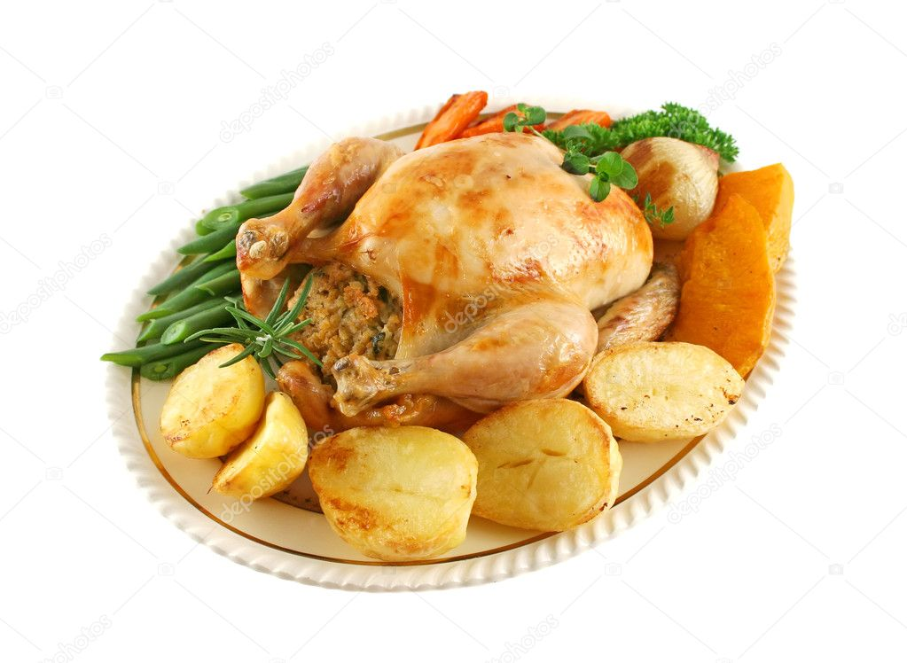 Whole roast chicken with potatoes pumkin carrots and beans. — Stock Photo #11386746