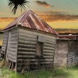 Stock Photo: Dilapidated Huts By Water