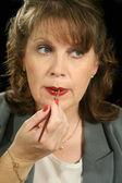 Lip Gloss Businesswoman 1 — Stock Photo
